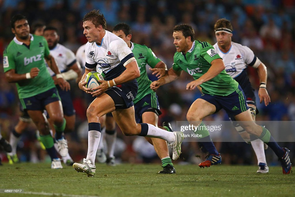 Cam Crawford of the Waratahs makes a break during the Super Rugby trial match between the Waratahs and the Highlanders at Hunter Stadium on February 14, 2014 in Newcastle, Australia.