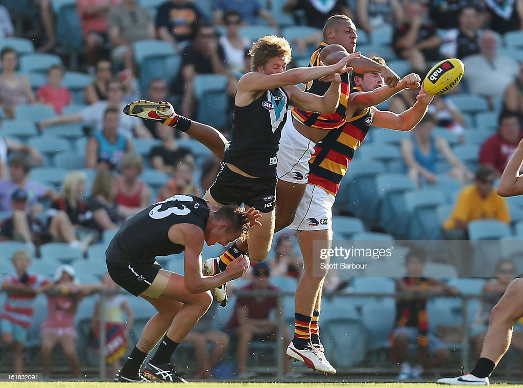 Cam Ellis-Yolmen of the Crows and Aaron Young of the Power compete for the ball during the round one AFL NAB Cup match between the Adelaide Crows and the Port Adelaide Power at AAMI Stadium on February 17, 2013 in Adelaide, Australia.