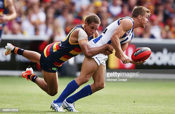 Cam EllisYolmen of the Crows tackles Andrew Swallow of the Kangaroos during the round one AFL match between the Adelaide Crows and the North...