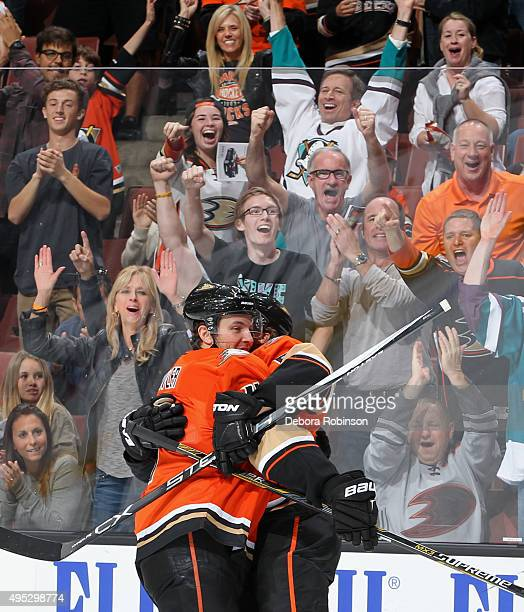 Cam Fowler and Rickard Rakell of the Anaheim Ducks celebrate a first period goal against the Nashville Predators on November 1 2015 at Honda Center...