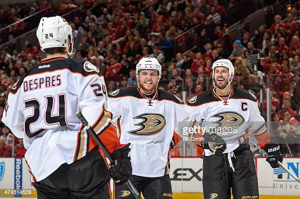Cam Fowler and Ryan Getzlaf of the Anaheim Ducks react after Simon Despres scored against the Chicago Blackhawks in the second period in Game Three...