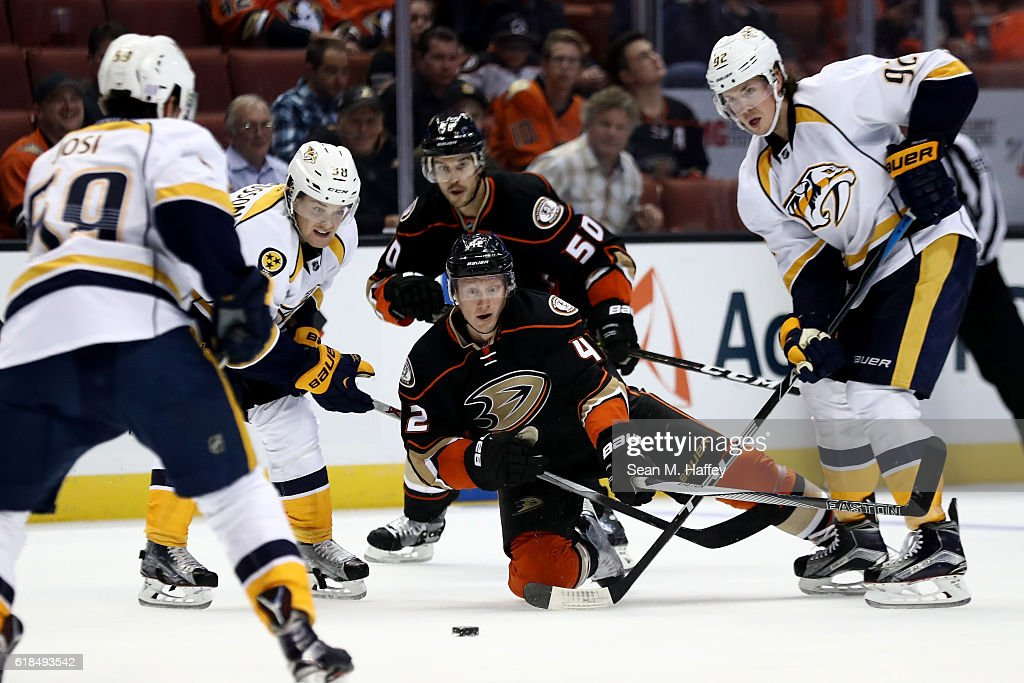 Cam Fowler #4, Antoine Vermette #50 of the Anaheim Ducks battle Ryan Johansen #92, and Viktor Arvidsson #38 of the Nashville Predators for a loose puck during the third period of a game at Honda Center on October 26, 2016 in Anaheim, California.