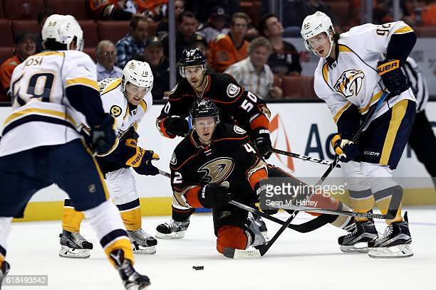 Cam Fowler Antoine Vermette of the Anaheim Ducks battle Ryan Johansen and Viktor Arvidsson of the Nashville Predators for a loose puck during the...