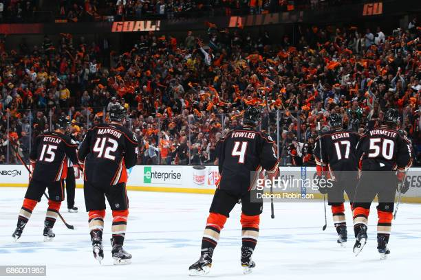 Cam Fowler Josh Manson Ryan Getzlaf Ryan Kesler and Antoine Vermette of the Anaheim Ducks skate to the bench to celebrate a goal against the...