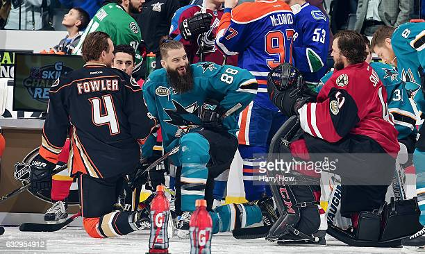 Cam Fowler of the Anaheim Ducks and Brent Burns of the San Jose Sharks joke during the 2017 Coors Light NHL AllStar Skills Competition as part of the...