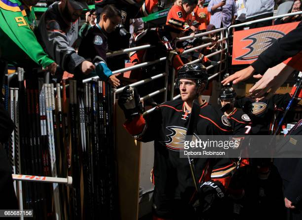 Cam Fowler of the Anaheim Ducks and fans fist bump as Fowler takes the ice before the game against the Calgary Flames at Honda Center on April 4 2017...