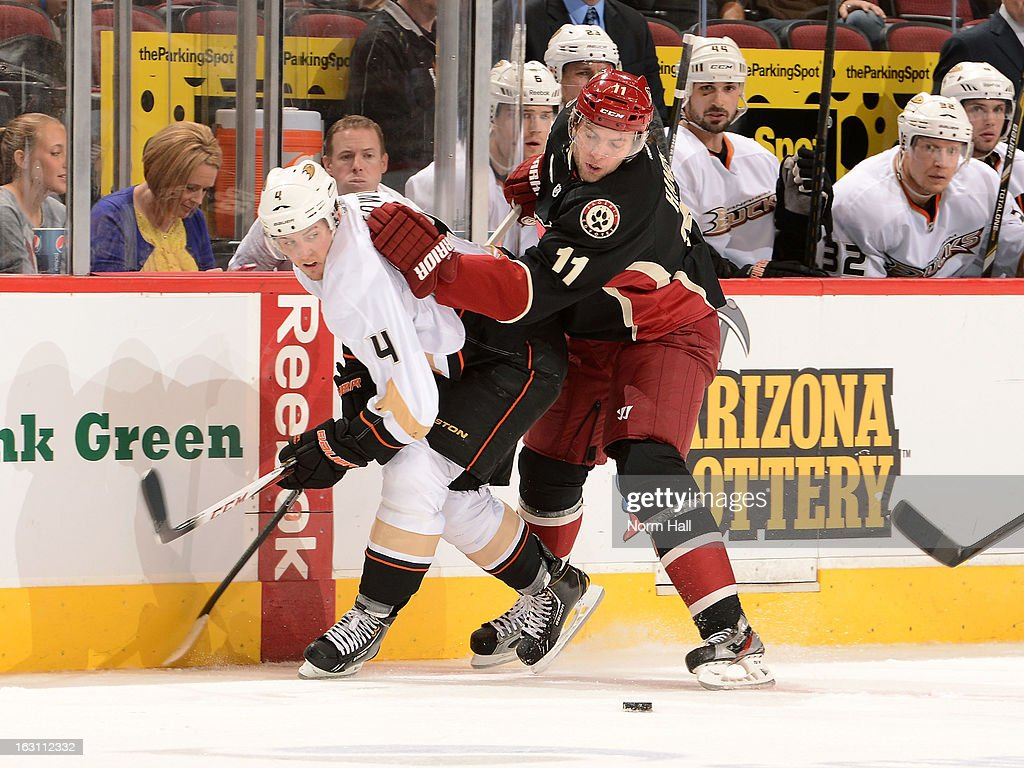 Cam Fowler #4 of the Anaheim Ducks and Martin Hanzal #11 of the Phoenix Coyotes battle for control of the puck during the second period at Jobing.com Arena on March 4, 2013 in Glendale, Arizona.