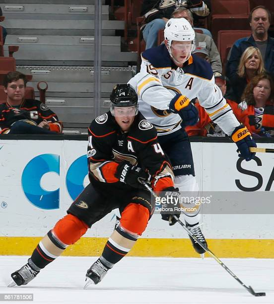 Cam Fowler of the Anaheim Ducks battles against Jack Eichel of the Buffalo Sabres during the game on October 15 2017 at Honda Center in Anaheim...