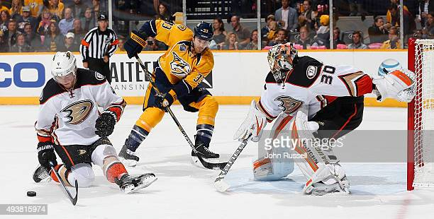 Cam Fowler of the Anaheim Ducks blocks a shot in front of goalie Anton Khudobin as Colin Wilson of the Nashville Predators skates in during an NHL...