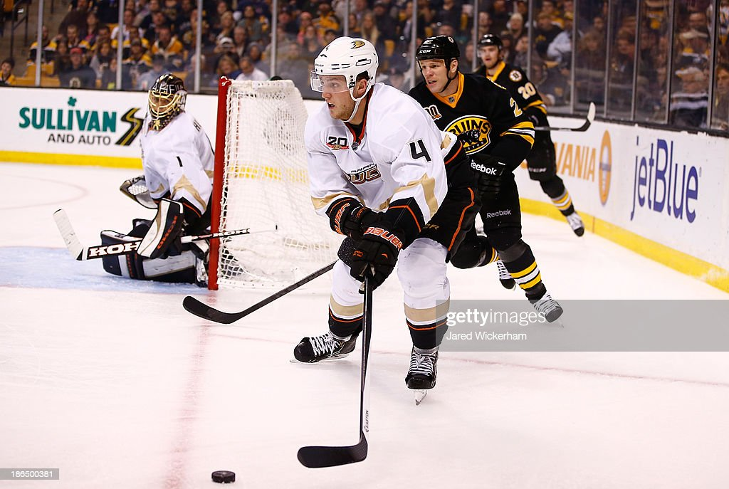 Cam Fowler #4 of the Anaheim Ducks carries the puck in the corner against the Boston Bruins in the third period at TD Garden on October 31, 2013 in Boston, Massachusetts.