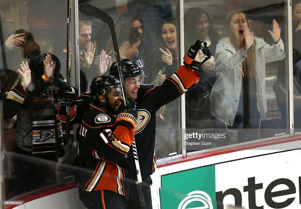 Cam Fowler #4 of the Anaheim Ducks celebrates with Devante Smith-Pelly #12 after scoring the game winning goal in overtime against the Vancouver Canucks at Honda Center on December 28, 2014 in Anaheim, California. The Ducks won 2-1 in overtime.