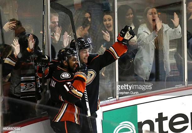 Cam Fowler of the Anaheim Ducks celebrates with Devante SmithPelly after scoring the game winning goal in overtime against the Vancouver Canucks at...