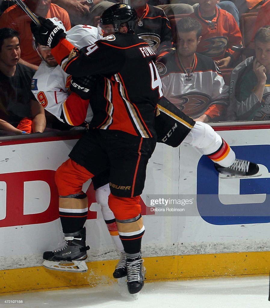 Cam Fowler #4 of the Anaheim Ducks checks David Jones #19 of the Calgary Flames into the boards during the third period in Game Two of the Western Conference Semifinals during the 2015 NHL Stanley Cup Playoffs at Honda Center on May 3, 2015 in Anaheim, California. The Ducks won 3-0.