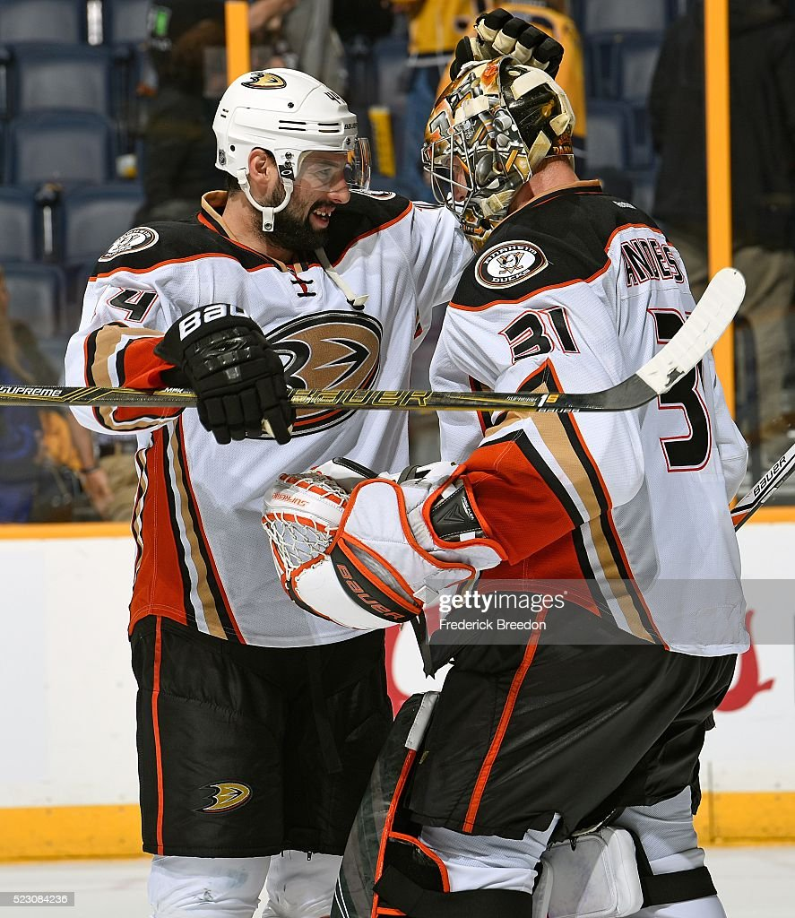 Cam Fowler #4 of the Anaheim Ducks congratulates teammate goalie Frederik Andersen #31 after a 4-1 victory over the Nashville Predators in Game Four of the Western Conference First Round during the 2016 NHL Stanley Cup Playoffs at Bridgestone Arena on April 19, 2016 in Nashville, Tennessee.