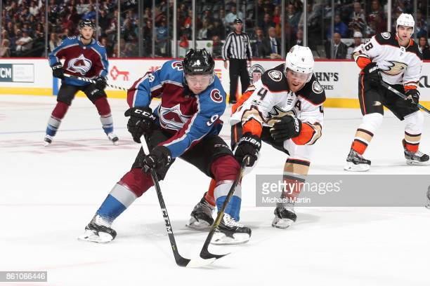 Cam Fowler of the Anaheim Ducks defends against Matt Duchene of the Colorado Avalanche at the Pepsi Center on October 13 2017 in Denver Colorado