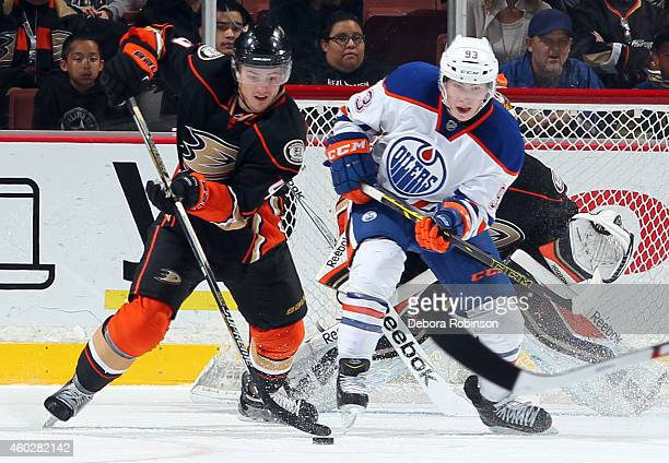 Cam Fowler of the Anaheim Ducks handles the puck against Ryan NugentHopkins of the Edmonton Oilers on December 10 2014 at Honda Center in Anaheim...