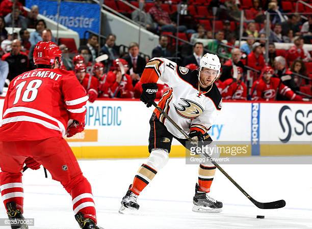 Cam Fowler of the Anaheim Ducks looks to pass the puck during an NHL game against the Carolina Hurricanes on November 10 2016 at PNC Arena in Raleigh...