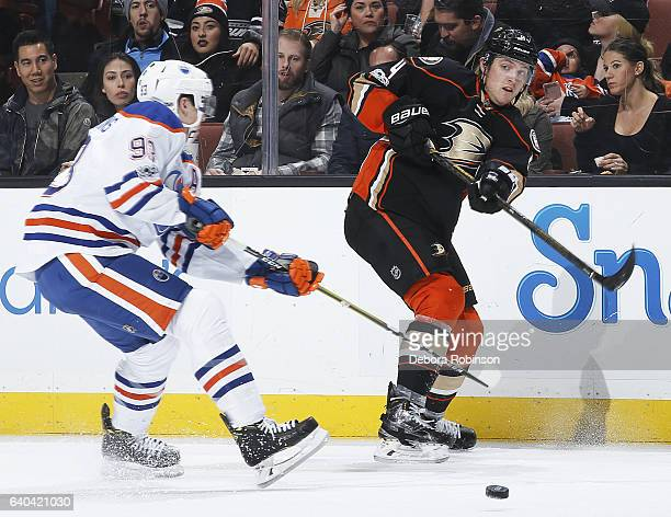 Cam Fowler of the Anaheim Ducks passes the puck with pressure from Ryan NugentHopkins of the Edmonton Oilers during the game on January 25 2017 at...