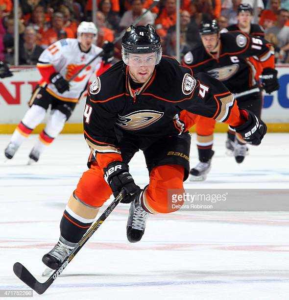Cam Fowler of the Anaheim Ducks races to the puck against the Calgary Flames during the second period in Game One of the Western Conference...