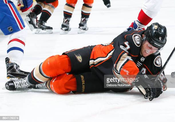 Cam Fowler of the Anaheim Ducks reacts after he was injured when an opponent's stick became lodged in his skate during the first period of the game...