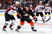 Cam Fowler of the Anaheim Ducks skates against Ryan O'Reilly of the Colorado Avalanche on April 13 2014 at Honda Center in Anaheim California