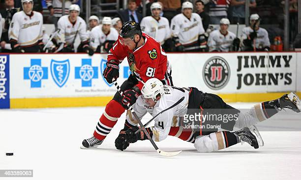 Cam Fowler of the Anaheim Ducks tries to take down Marian Hossa of the Chicago Blackhawks as Hossa moves to score and empty net goal late in the...