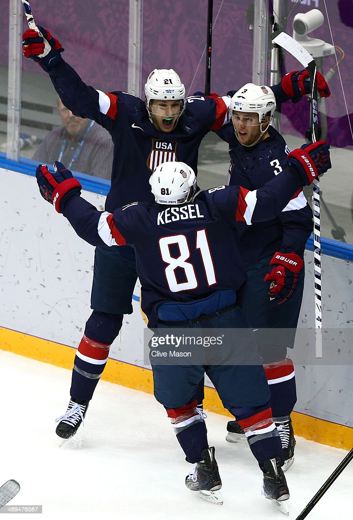 <a gi-track='captionPersonalityLinkClicked' href=/galleries/search?phrase=Cam+Fowler&family=editorial&specificpeople=5484080 ng-click='$event.stopPropagation()'>Cam Fowler</a> #3 of the United States celebrates with teammates James van Riemsdyk #21 and <a gi-track='captionPersonalityLinkClicked' href=/galleries/search?phrase=Phil+Kessel&family=editorial&specificpeople=537794 ng-click='$event.stopPropagation()'>Phil Kessel</a> #81 of the United States after scoring a goal against Sergei Bobrovski #72 of Russia in the second period during the Men's Ice Hockey Preliminary Round Group A game on day eight of the Sochi 2014 Winter Olympics at Bolshoy Ice Dome on February 15, 2014 in Sochi, Russia.