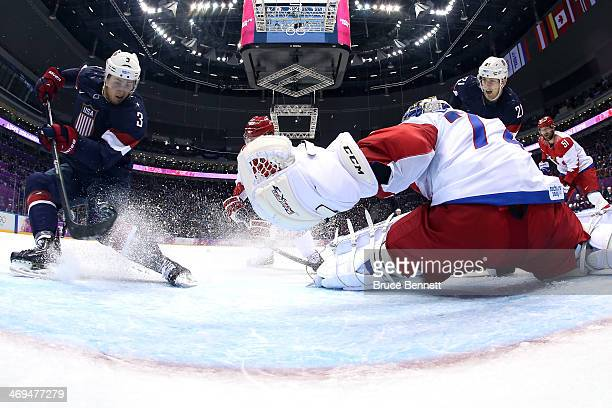 Cam Fowler of the United States scores a goal against Sergei Bobrovski of Russia during the Men's Ice Hockey Preliminary Round Group A game on day...