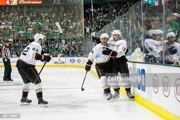 Cam Fowler Patrick Maroon and Nick Bonino of the Anaheim Ducks celebrate a game winning overtime goal against the Dallas Stars in Game Six of the...