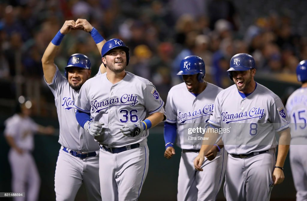 Cam Gallagher #36 of the Kansas City Royals is congratulated by Melky Cabrera #53, Alcides Escobar #2 and Mike Moustakas #8 after he hit a grand slam home run in the sixth inning against the Oakland Athletics at Oakland Alameda Coliseum on August 14, 2017 in Oakland, California.