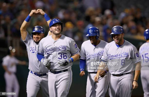 Cam Gallagher of the Kansas City Royals is congratulated by Melky Cabrera Alcides Escobar and Mike Moustakas after he hit a grand slam home run in...
