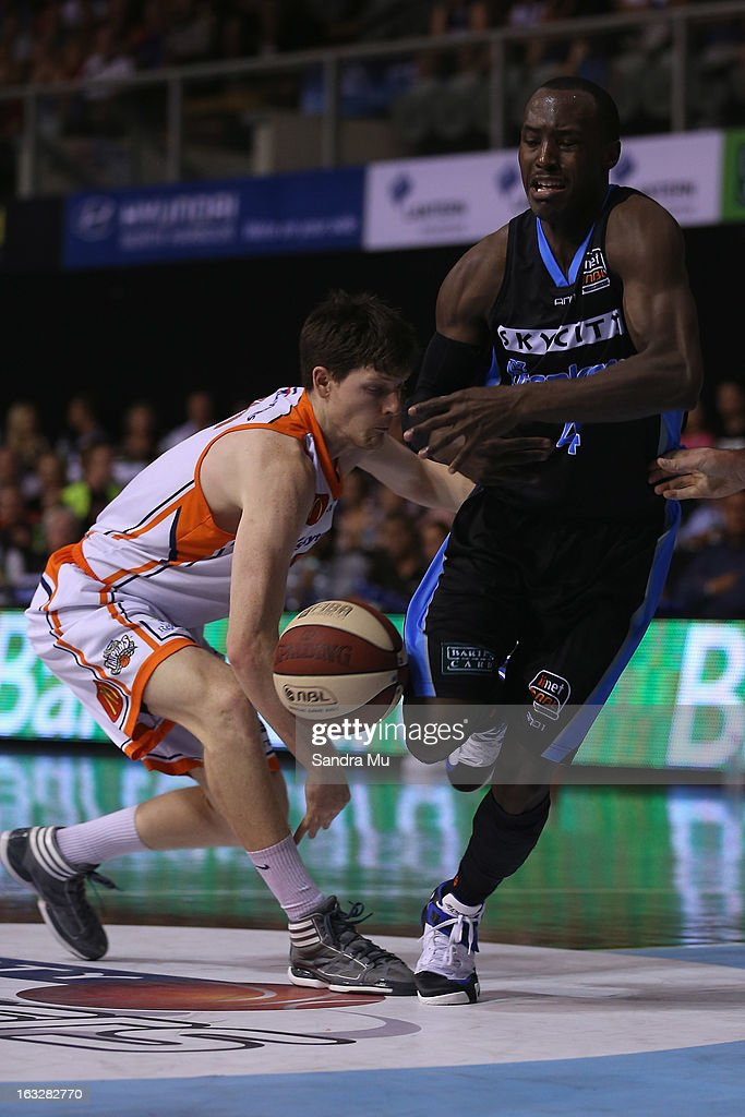 Cam Gliddon of the Titans (L) and Cedric Jackson of the Breakers in action during the round 22 NBL match between the New Zealand Breakers and the Cairns Taipans at North Shore Events Centre on March 7, 2013 in Auckland, New Zealand.