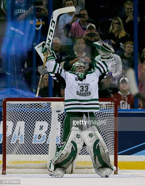 Cam Johnson of the North Dakota Fighting Hawks celebrates the win over the Denver Pioneers during semifinals of the 2016 NCAA Division I Men's Hockey...
