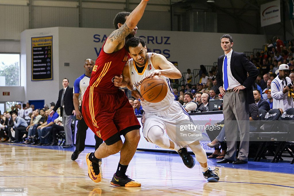 Cam Jones #9 of the Santa Cruz Warriors drives to the basket against <a gi-track='captionPersonalityLinkClicked' href=/galleries/search?phrase=Trey+McKinney+Jones&family=editorial&specificpeople=8624313 ng-click='$event.stopPropagation()'>Trey McKinney Jones</a> #11 of the Fort Wayne Mad Ants in the NBADLeague Finals on April 24, 2014 at Kaiser Permanente Arena in Santa Cruz, California.