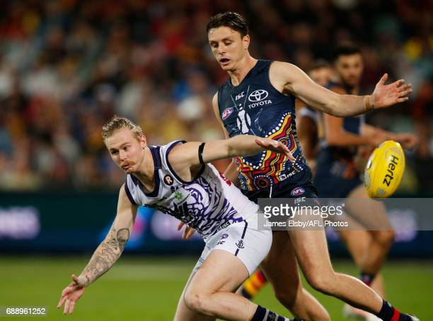 Cam McCarthy of the Dockers is tackled by Jake Lever of the Crows during the 2017 AFL round 10 match between the Adelaide Crows and the Fremantle...