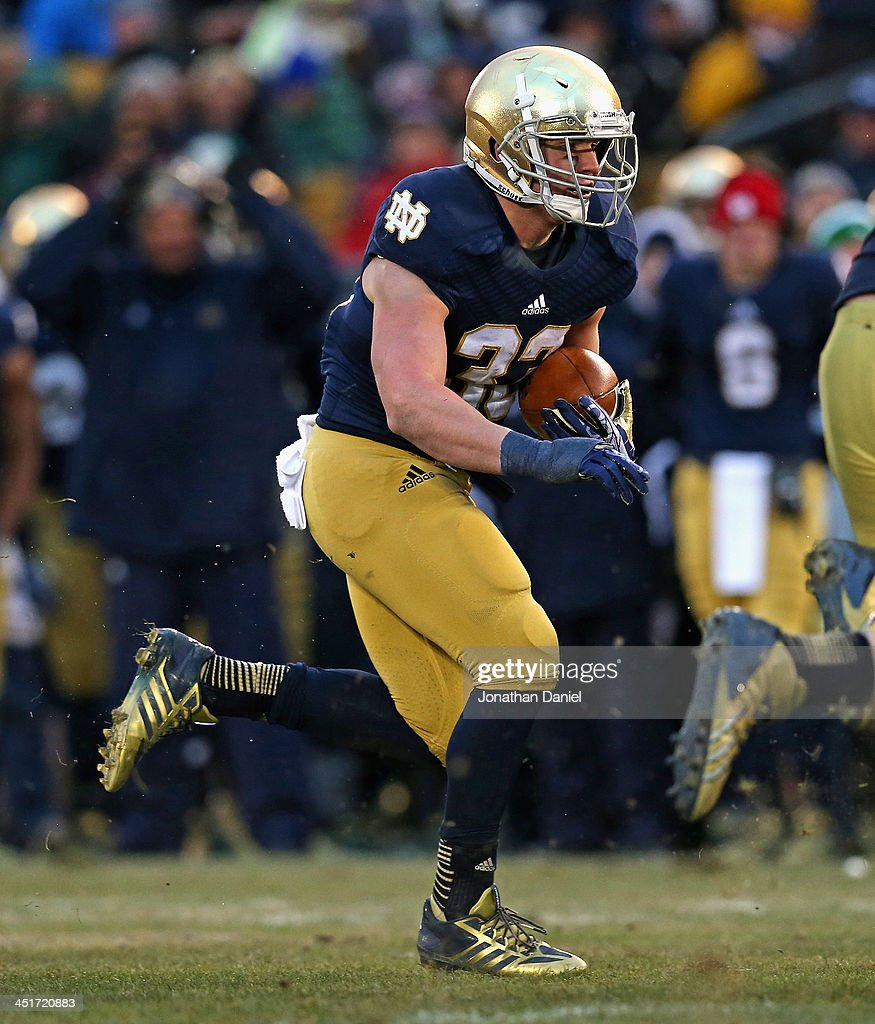 <a gi-track='captionPersonalityLinkClicked' href=/galleries/search?phrase=Cam+McDaniel&family=editorial&specificpeople=9937391 ng-click='$event.stopPropagation()'>Cam McDaniel</a> #33 of the Notre Dame Fighting Irish runs against the Brigham Young Cougars at Notre Dame Stadium on November 23, 2013 in South Bend, Indiana. Notre Dame defeated BYU