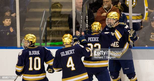 Cam Morrison of the Notre Dame Fighting Irish celebrates his second goal of the game with teammate Andrew Peeke Anders Bjork and Dennis Gilbert...
