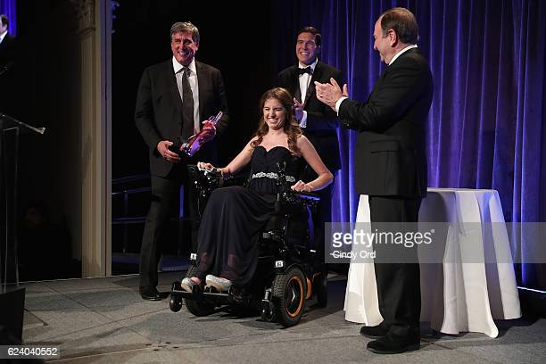 Cam Neely Denna Laing Will Reeve and Gary Bettman speak on stage during the Christopher Dana Reeve Foundation hosts 'A Magical Evening' at Cipriani...