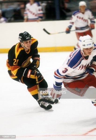 Cam Neely of the Vancouver Canucks chases down James Patrick of the New York Rangers during their game on October 20 1985 at the Madison Square...
