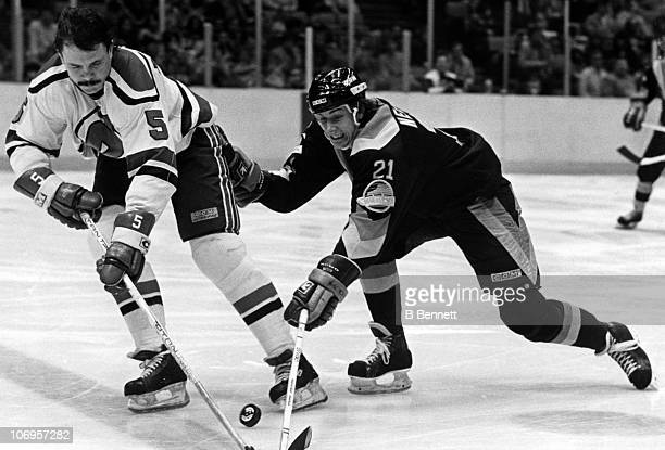 Cam Neely of the Vancouver Canucks chases down Phil Russell of the New Jersey Devils during their game on March 2 1984 at the Brendan Byrne Arena in...