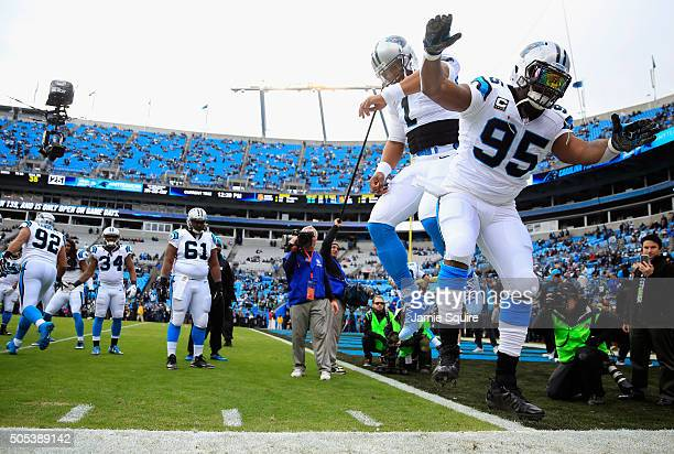 Cam Newton and Charles Johnson of the Carolina Panthers warm up prior to the NFC Divisional Playoff Game against the Seattle Seahawks at Bank of...