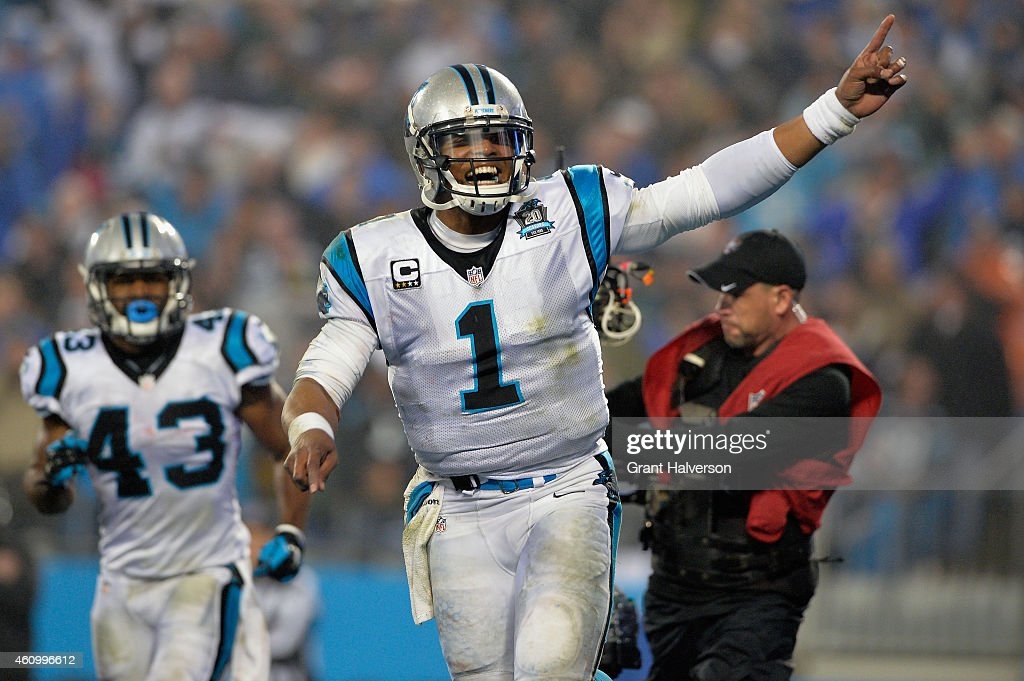 Cam Newton #1 and Fozzy Whittaker #43 of the Carolina Panthers celebrate during their NFC Wild Card Playoff game against the Arizona Cardinals at Bank of America Stadium on January 3, 2015 in Charlotte, North Carolina.