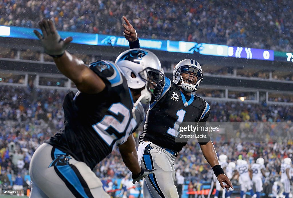 Cam Newton #1 and Jonathan Stewart #28 of the Carolina Panthers celebrate a touchdown against the Indianapolis Colts in the 1st quarter during their game at Bank of America Stadium on November 2, 2015 in Charlotte, North Carolina.