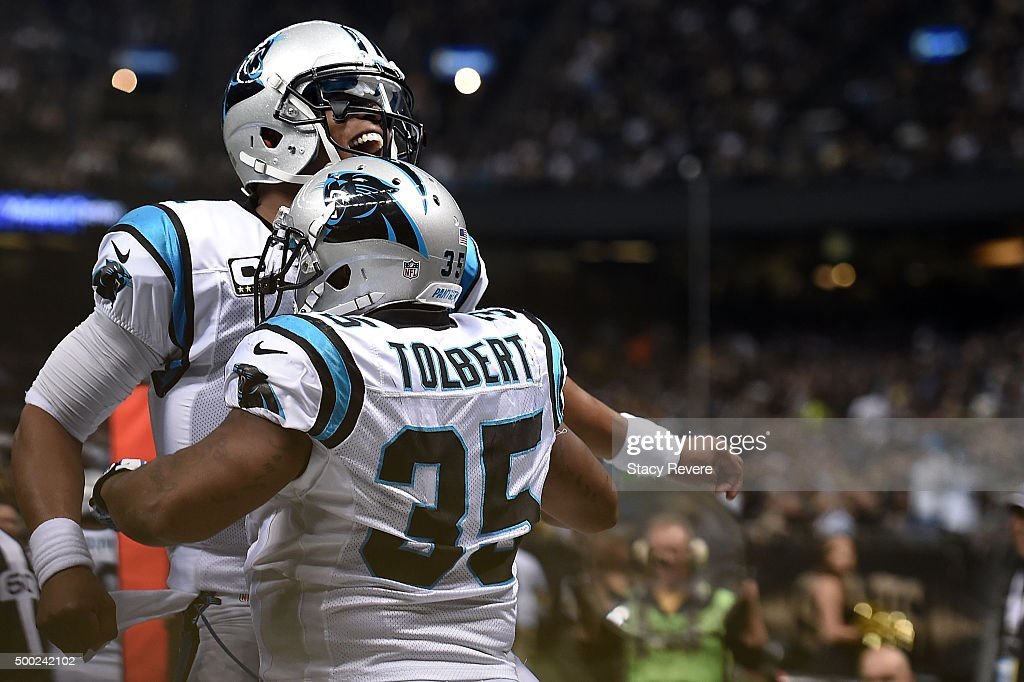 Cam Newton and Mike Tolbert of the Carolina Panthers celebrate a touchdown during the second quarter of a game against the New Orleans Saints at the...
