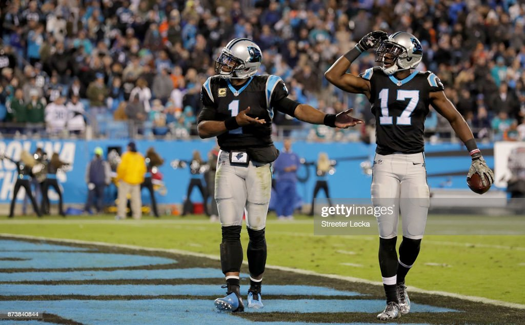 Cam Newton #1 and teammate Devin Funchess #17 of the Carolina Panthers celebrate a touchdown against the Miami Dolphins in the third quarter during their game at Bank of America Stadium on November 13, 2017 in Charlotte, North Carolina.