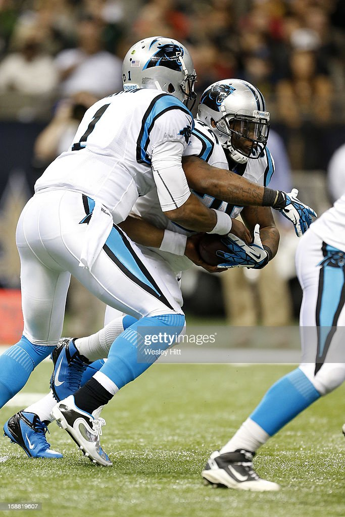 Cam Newton #1 hands off the ball to Mike Tolbert #35 of the Carolina Panthers during a game against the New Orleans Saints at Mercedes-Benz Superdome on December 30, 2012 in New Orleans, Louisiana. The Panthers defeated the Saints 44-38.