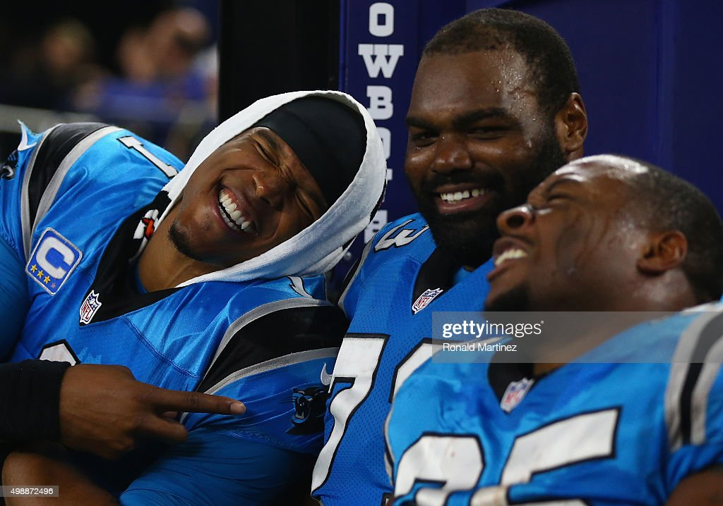 Cam Newton #1, Michael Oher #73 and Mike Tolbert #35 of the Carolina Panthers laugh during a 33-14 win against the Dallas Cowboys at AT&T Stadium on November 26, 2015 in Arlington, Texas.