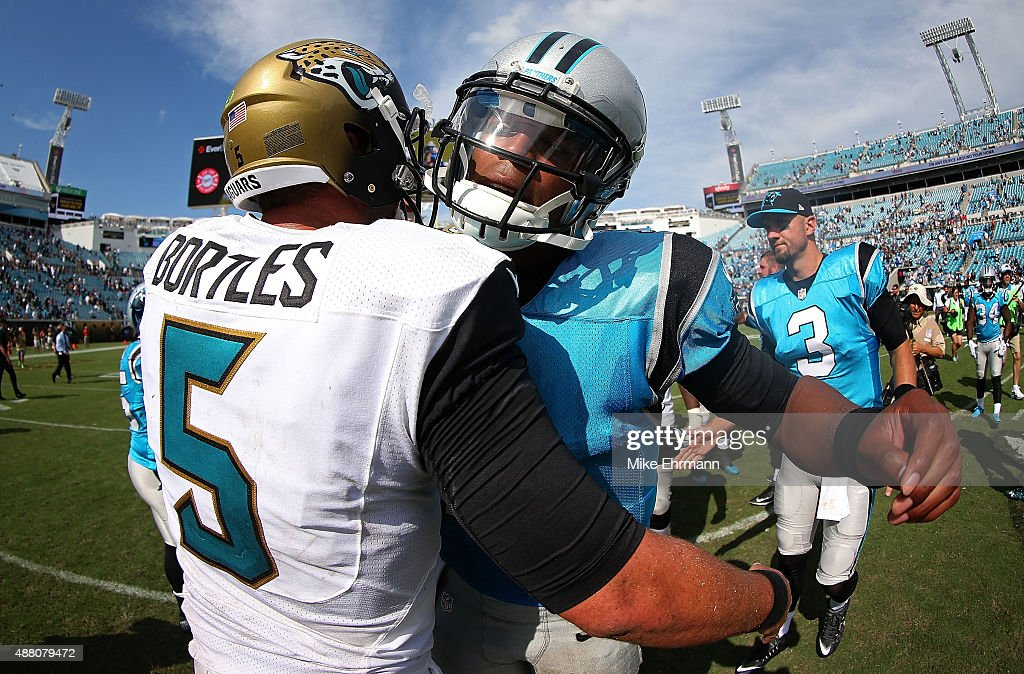 Cam Newton of the Carolina Panthers and Blake Bortles of the Jacksonville Jaguars shake hands during a game at EverBank Field on September 13 2015 in...