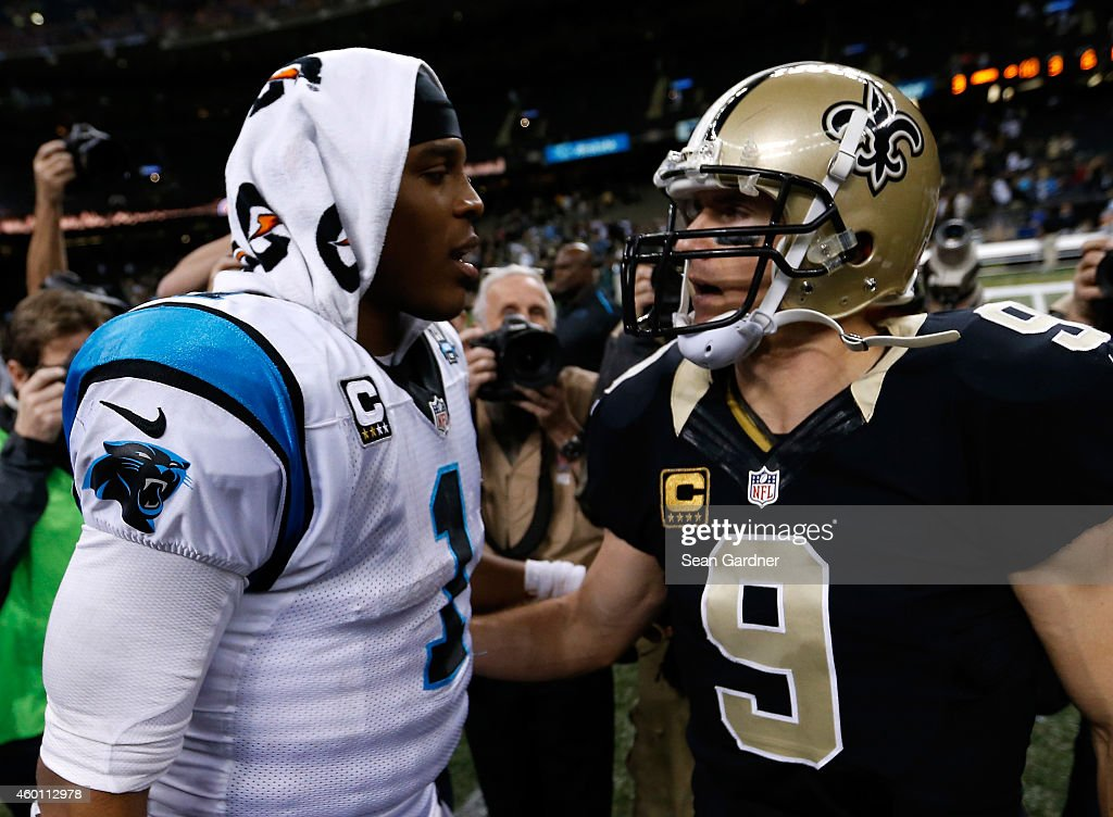 Cam Newton #1 of the Carolina Panthers and Drew Brees #9 of the New Orleans Saints greet each other after the game at Mercedes-Benz Superdome on December 7, 2014 in New Orleans, Louisiana.