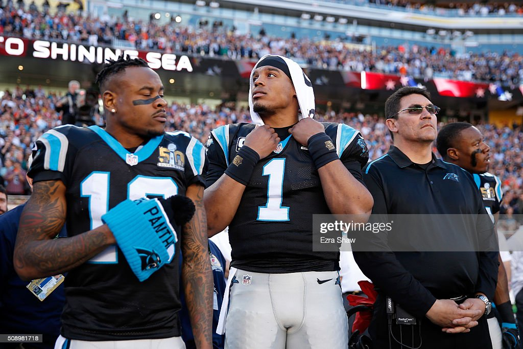 Cam Newton #1 of the Carolina Panthers and head coach <a gi-track='captionPersonalityLinkClicked' href=/galleries/search?phrase=Ron+Rivera&family=editorial&specificpeople=590509 ng-click='$event.stopPropagation()'>Ron Rivera</a> of the Carolina Panthers stand on the field prior to Super Bowl 50 at Levi's Stadium on February 7, 2016 in Santa Clara, California.